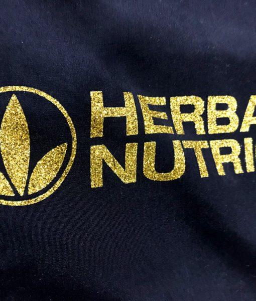 Impresionarte-Xativa-Nutricion-Herbalife-mochila-dual-saco-asas-cordones-purpurina-dorada-gold-oro-glitter-hbl-evento